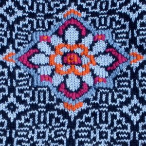 embroidery and knitting close up on Norwegian, Fair Isle and Asian influenced knitwear design