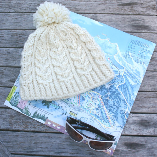Snowbird Hat, a chunky knit cabled knitting pattern design by Mary Ann Stephens