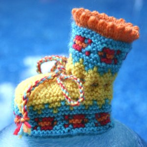 Knit booties with fish motif knit in Dale of Norway Baby Ull merino wool yarn