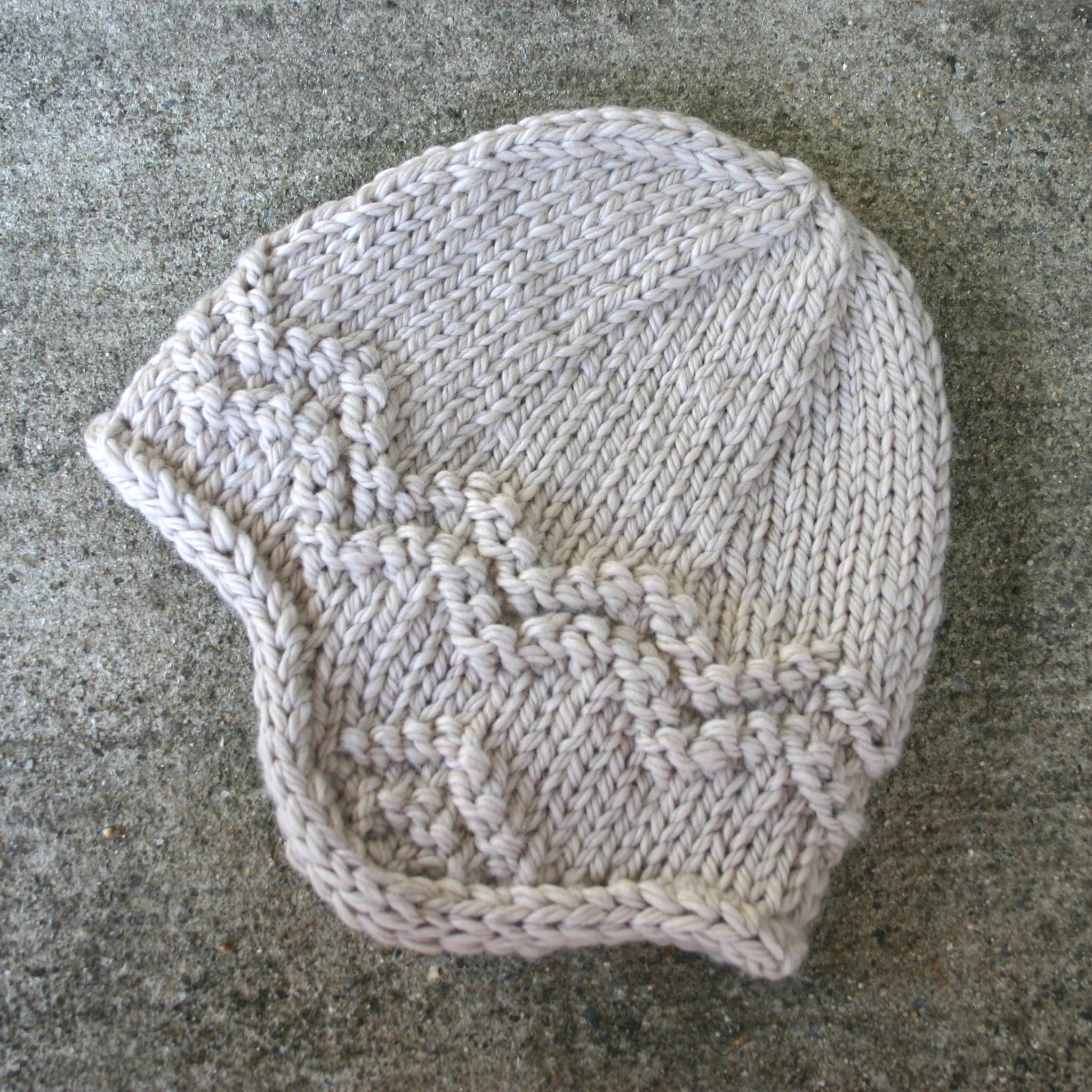Free knitting pattern for an adults earflap hat, knit in bulky weight wool.