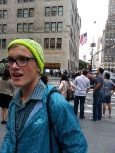 Teen wears NY Nordic Hat knit in neon Dale Freestyle yarn